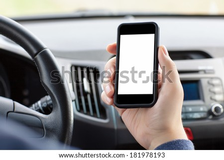 man sitting in the car and holding a touch phone with isolated screen  - stock photo