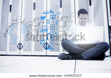 Man sitting next to a drawing of a planet with different icons - stock photo