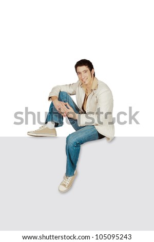 man sitting on a blank gray sign. All on white background. - stock photo