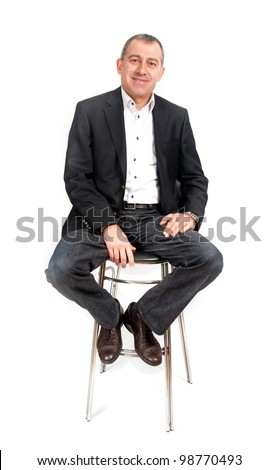 Man sitting on bar chair - stock photo
