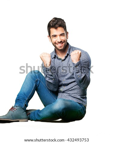 man sitting on the floor winning - stock photo