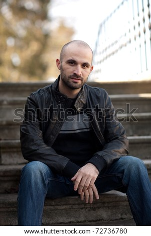 Man sitting on the stairs - stock photo