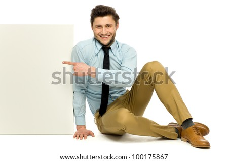 Man sitting with blank poster - stock photo