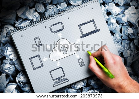 man sketching cloud and connected devices - stock photo