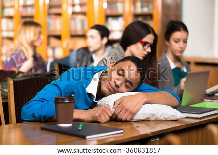 Man sleeping during lessons or classes - stock photo