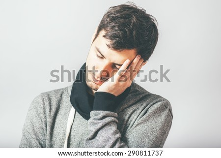 man sleeps on his arm - stock photo