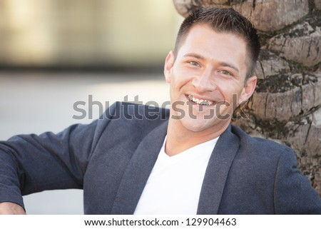 Man smiling and wearing a sport coat - stock photo