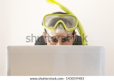 Man smiling at web prices for your holidays and trips - stock photo