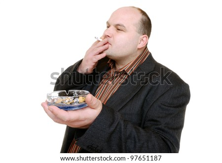 man smokes a cigarette - stock photo