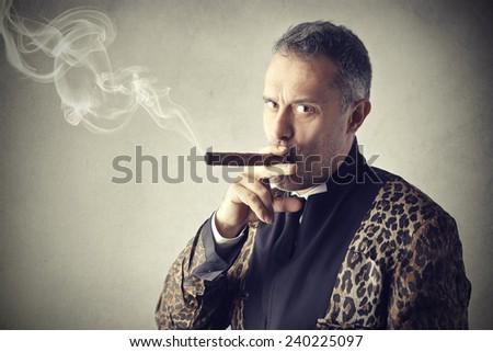 Man smoking a cigar  - stock photo