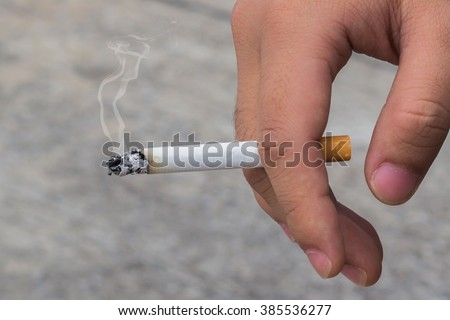 man smoking a cigarette  - stock photo