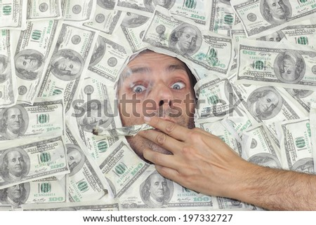 man smoking a hundred dollars note - stock photo
