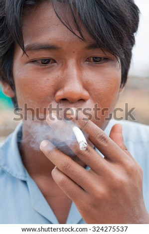 Man smoking.Selective focus. Very shallow Depth of Field, for soft background. - stock photo