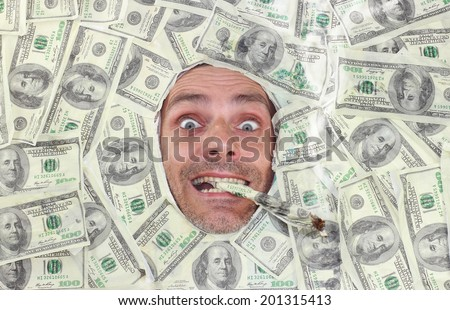 man smoking smoking hundred dollar notes - stock photo
