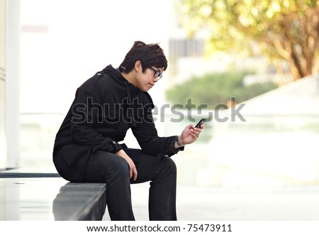 man sms on cell phone - stock photo