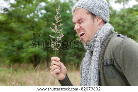man sneezing - stock photo