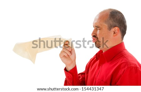 Man sneezing and holding a handkerchief -  isolated on white. - stock photo