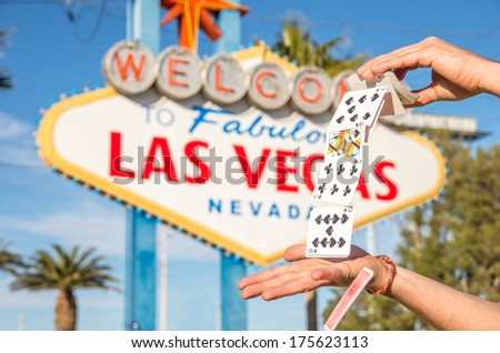 Man springing card in front of Las Vegas sign - stock photo