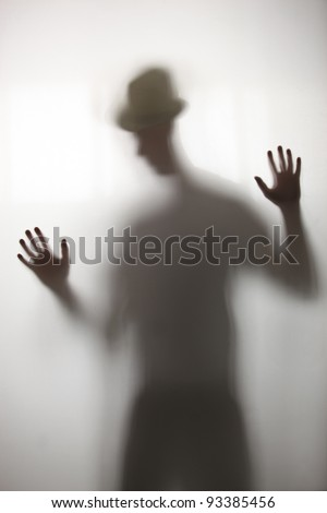 man standing behind a screen - stock photo