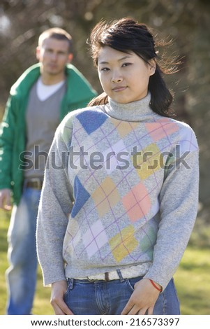 Man standing behind confident woman - stock photo