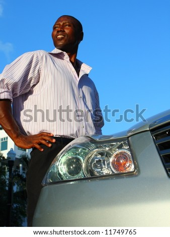 Man standing by his car - stock photo