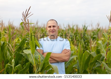 man standing in field of corn - stock photo