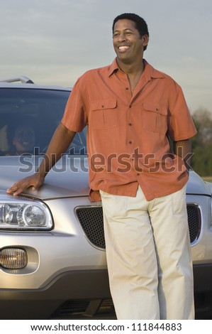 Man standing in front a car - stock photo