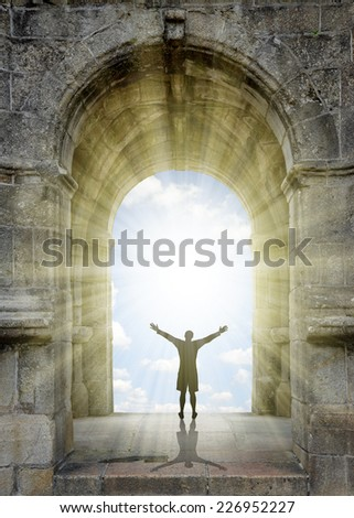 Man standing in front of the gate to heaven. - stock photo