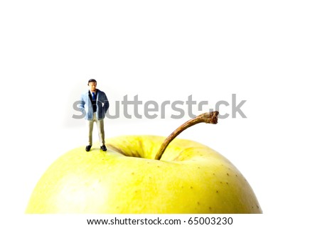 man standing on apple - stock photo
