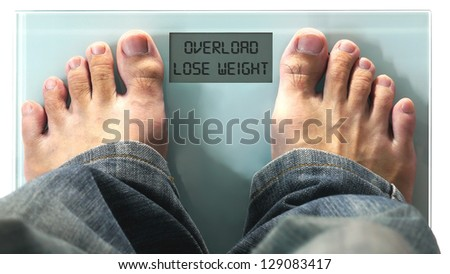 Man Standing on Digital Weighing Apparatus. - stock photo
