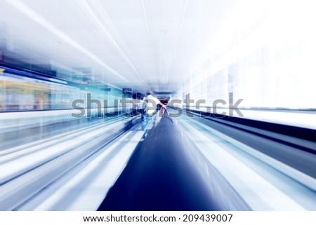 Man standing on moving futuristic escalator - stock photo