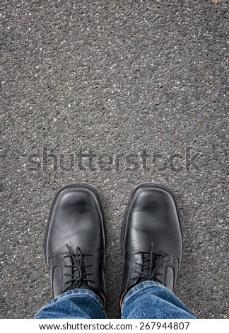 Man standing on the street with copy space - stock photo