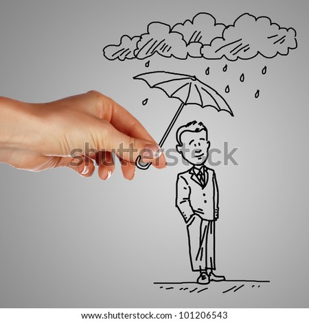 Man standing under the rain and protected with umbrella - stock photo