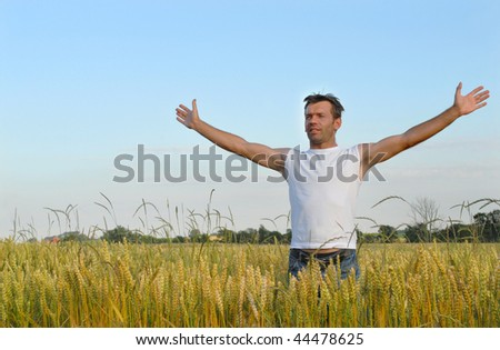 Man standing with his arms wide open - stock photo