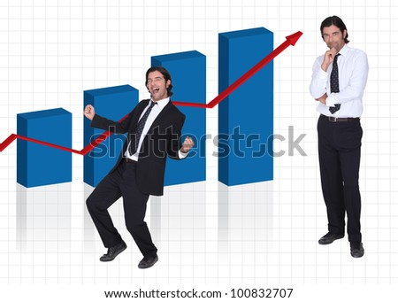 Man stood by graph of financial results - stock photo