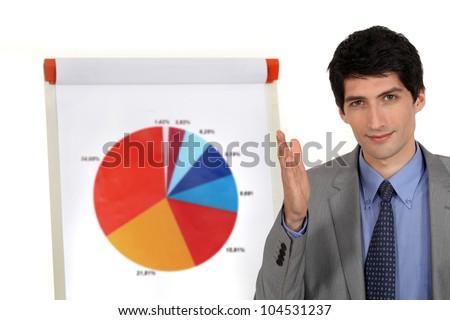 Man stood by pie-chart - stock photo