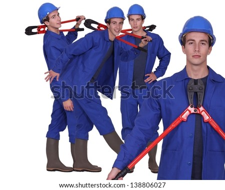 Man stood holding bolt-cutters - stock photo