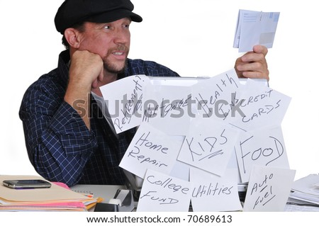 Man stressed and confused over the amount of bills he needs to pay. - stock photo