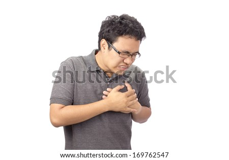 man suffering chest pain on white background - stock photo