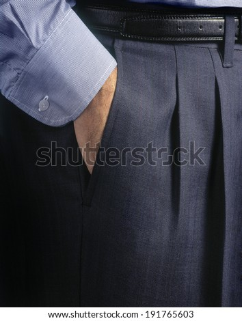 Man suit detail. Man holding hand in pocket  - stock photo