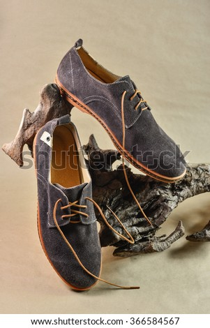 Man summer shoes on sepia backgrounds - stock photo