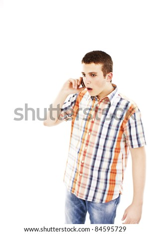 Man surprised on the phone on a white background - stock photo