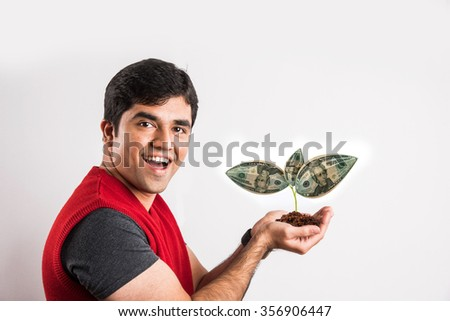 man surprised to see money or dollar grown on tree, brown man with money plant, young man with money plant, US paper currency growing on tree, happy  man, isolated on white background - stock photo