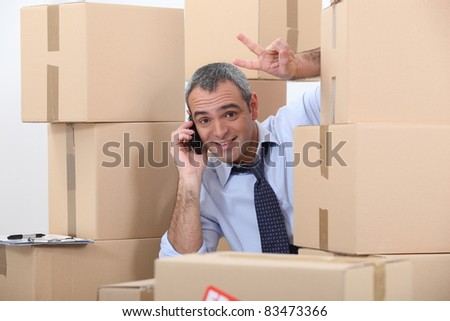 Man surrounded by cardboard boxes - stock photo