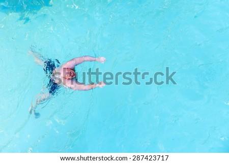Man swimming in swimming pool - stock photo