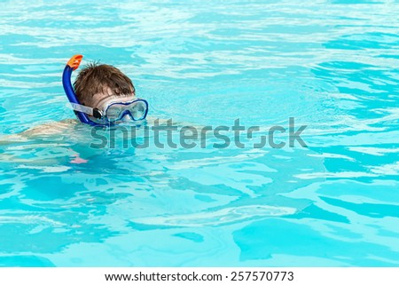 man swims in a crystal water pool - stock photo