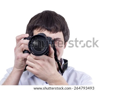 Man takes aim to carry out shooting with peephole camera isolated on white background - stock photo