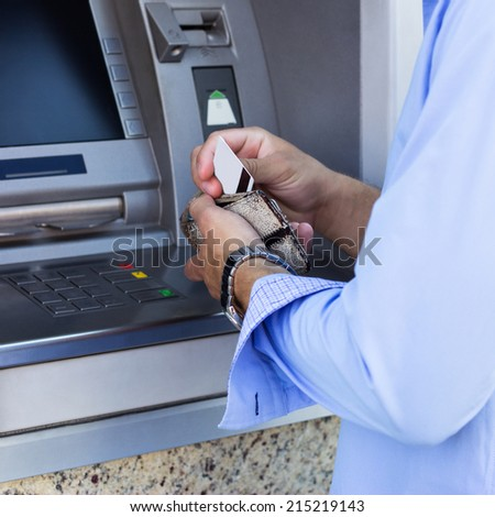 Man takes out a credit card from his wallet - stock photo