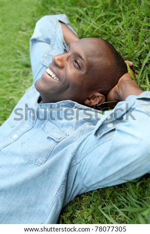 Man taking a nap in park - stock photo