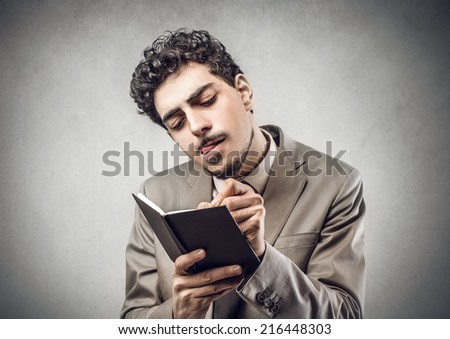 man taking notes - stock photo